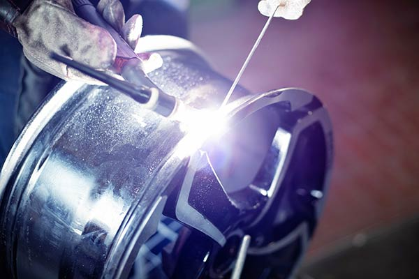Image of an alloy wheel being welded