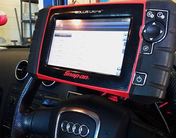 Diagnostic machine attached to the interior of a car
