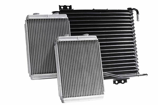 Three vehicle radiators displaed on a white background