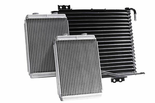 Three vehicle radiators displaed on a white background